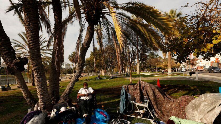 Residents of a homeless encampment in MacArthur Park in February.