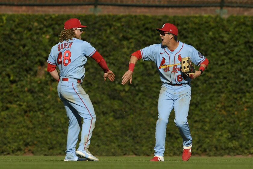 St. Louis Cardinals outfielders Lars Nootbaar, right, and Harrison Bader (48) celebrate after defeating the Chicago Cubs 8-5 in a baseball game Saturday, Sept. 25, 2021, in Chicago. (AP Photo/Paul Beaty)