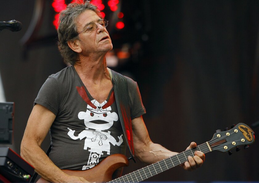FILE - In this Sunday, Aug. 9, 2009 file photo, Lou Reed performs at the Lollapalooza music festival, in Chicago. The rocker's life was decidedly unconventional, but he wanted his estate used for a very traditional purpose: to benefit his wife and other relatives. Reed's will was filed Monday, Nov.