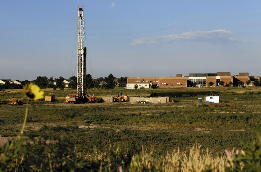 A drilling rig sits in a field in Colorado. Water samples collected at Colorado hydraulic fracturing sites show the presence of endocrine-disrupting chemicals, which can affect human hormones, scientists say.