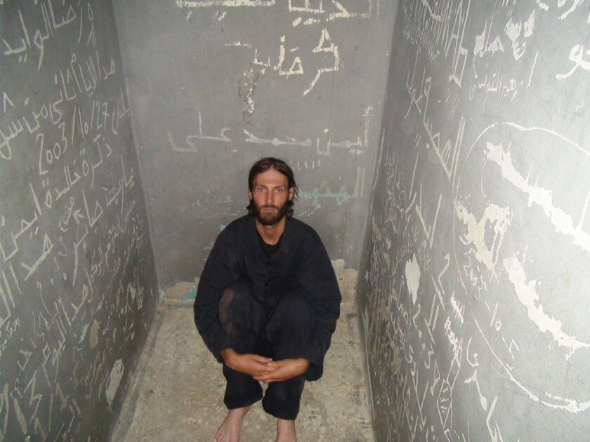 "Matthew VanDyke, subject of ""Point and Shoot,"" in solitary confinement in a Libyan prison in 2011."