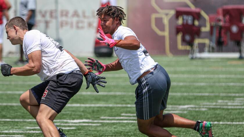 Pacifica linebacker tries to get physical with JSerra tight end Gary Morrison during a one-on-one drill at USC's Elite Camp on June 12.