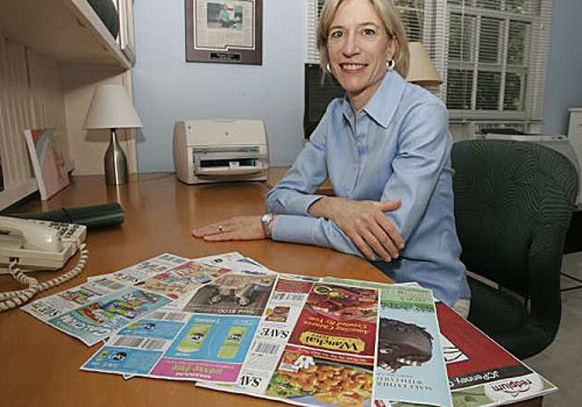 IT ADDS UP: Stephanie Nelson owns a website dedicated to coupons. Last year, Americans redeemed 2.6 billion coupons. The number is climbing this year as the economy continues to squeeze budgets, according to CouponInfoNow.com.