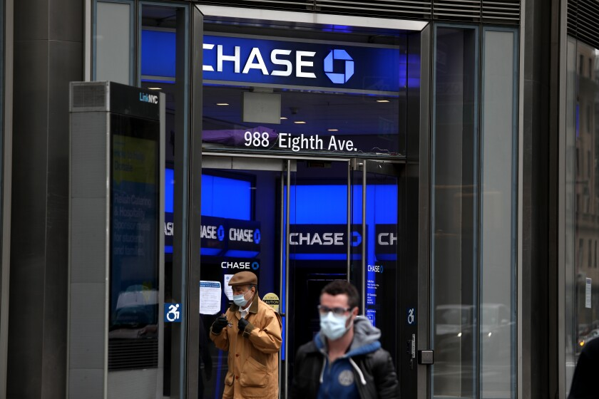 People pass a Chase bank in New York City on April 29.