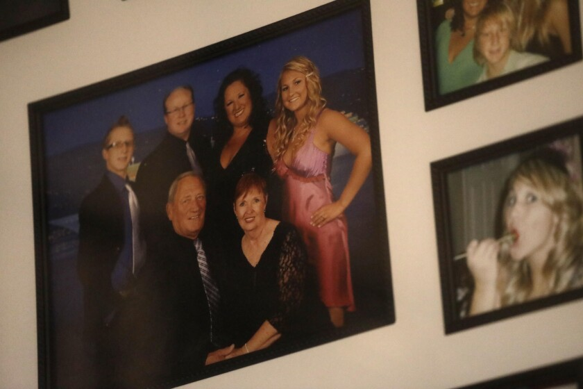 Framed photos hang on a wall