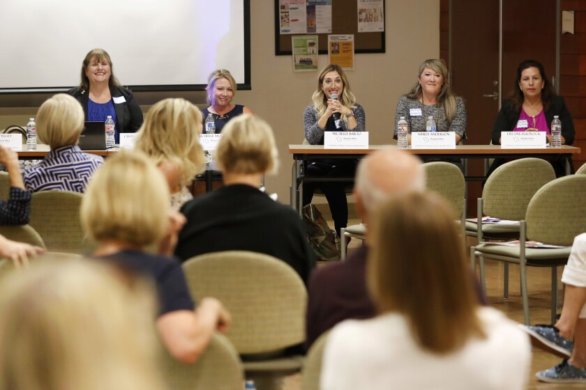 "Candidates for the Newport-Mesa Unified School District board of trustees take questions during a forum Tuesday presented by the Newport Beach Women's Democratic Club at the Oasis Senior Center in Corona del Mar. Pictured from left are Charlene Metoyer, Michelle Murphy, Michelle Barto, Ashley Anderson and Diane ""Dee Dee"" RuoRock."