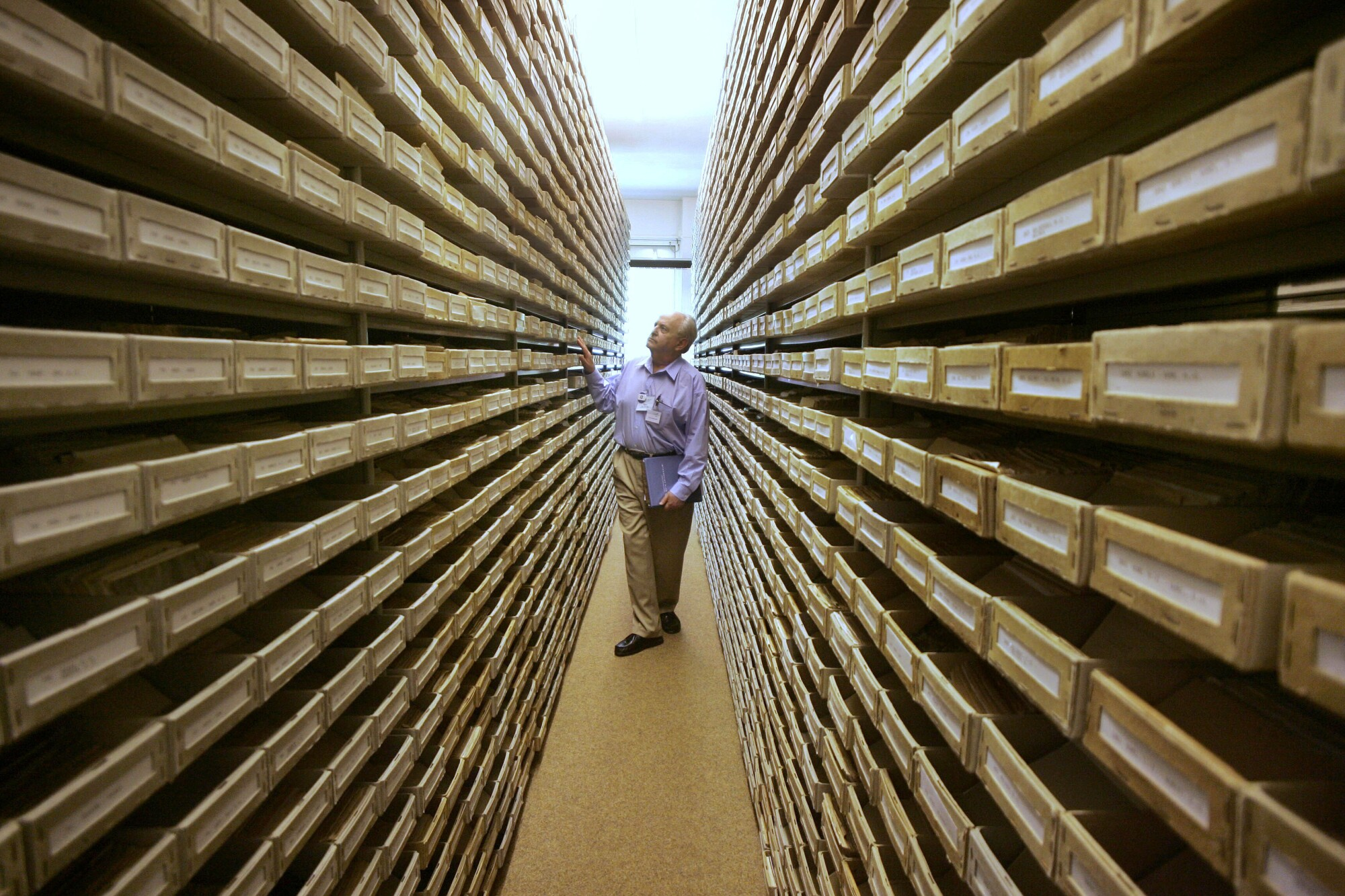 Gary Mokotoff, a Jewish genealogist from New Jersey, checks name registers at a Holocaust center in Bad Arolsen, Germany.