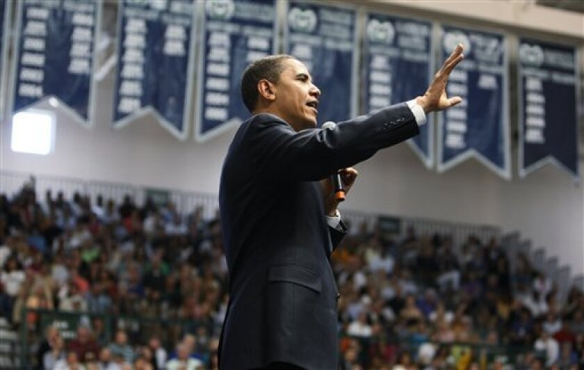 President Barack Obama speaks about credit card debt reform at a town hall style gathering at Rio Rancho High School in Rio Rancho, N.M., Thursday, May 14, 2009. (AP Photo/Charles Dharapak)