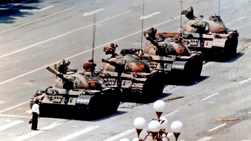 A demonstrator stands in front of a line of tanks in Beijing on June 5, 1989.
