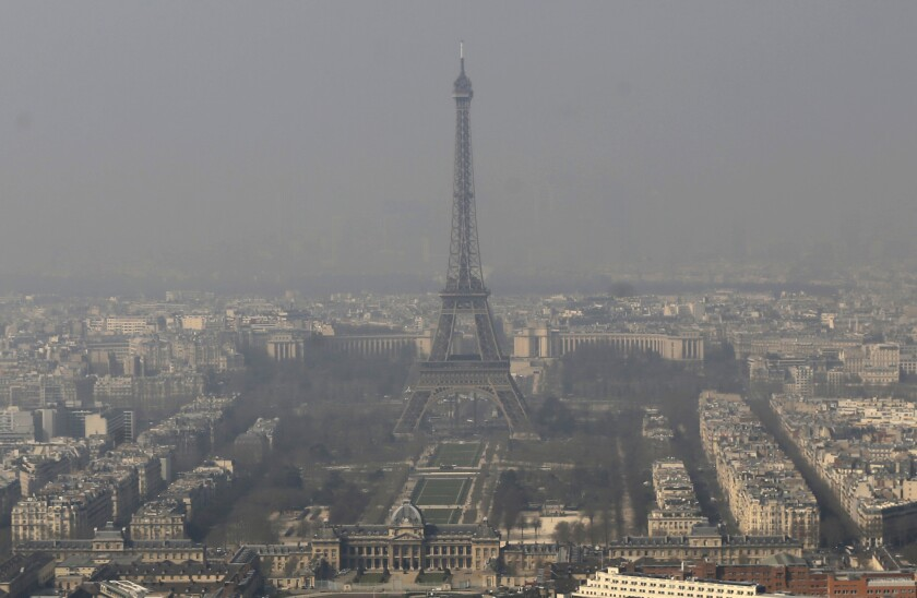 In smog-choked Paris, the Eiffel Tower is seen through the haze on March 14. For one day this month, air quality in the French capital was reported to be the worst among major global cities.