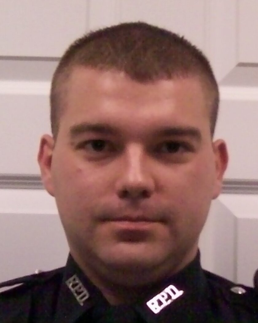 This photo released by Kentucky State Police shows Richmond Police Officer Daniel Ellis.  The central Kentucky police officer died early Friday, Nov. 6, 2015 two days after he was ambushed and shot in the head while searching an apartment for a robbery suspect, authorities said. (Kentucky State Pol