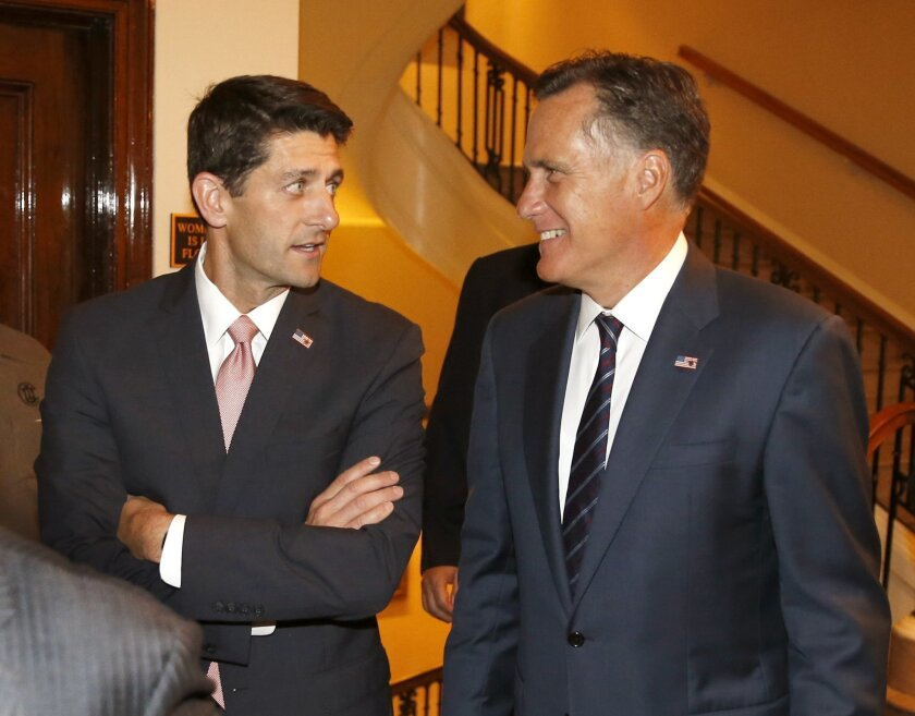 """Former Massachusetts Gov. Mitt Romney, right, and his former vice presidential running mate Rep. Paul Ryan, R-Wis., arrive for a dinner at the Union Club in Chicago where Romney interviewed Ryan about Ryan's new book, """"The Way Forward: Renewing the American Idea."""""""