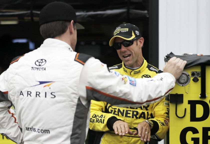 Matt Kenseth, right, and Carl Edwards talk during a practice session for Sunday's NASCAR Sprint Cup Series auto race, Friday, June 3, 2016, in Long Pond, Pa. (AP Photo/Matt Slocum)