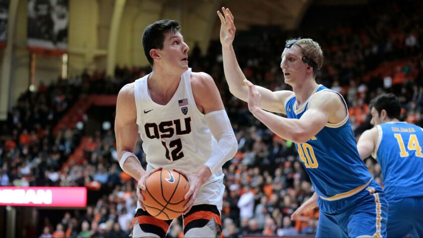 Oregon State's Drew Eubanks is defended by UCLA's Thomas Welsh during a recent game.