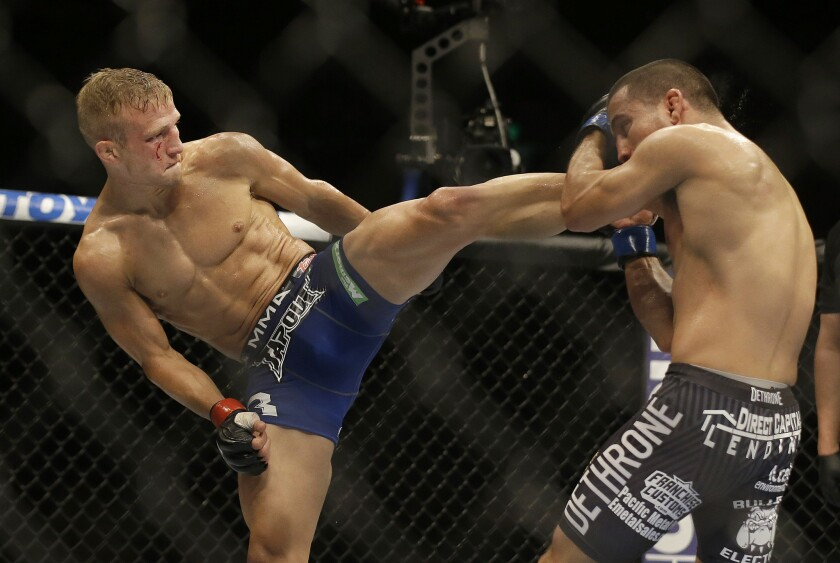 T.J. Dillashaw, left, kicks Joe Soto on his way to successfully defending his Ultimate Fighting Championship bantamweight belt at Sleep Train Arena in Sacramento on Aug. 30, 2014.