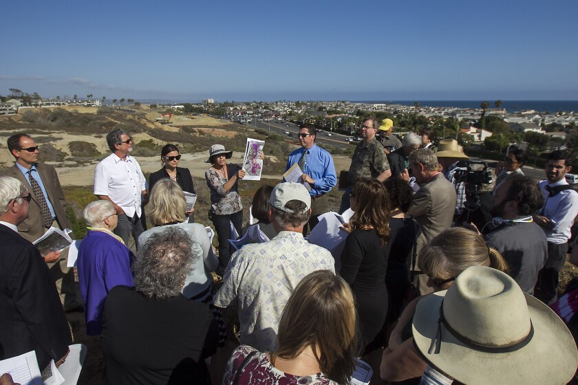 Coastal Commission staff members Karl Schwing and Jonna Engel lead a field trip for commissioners, staff and the general public of a proposed development project at Banning Ranch near Newport Beach on Wednesday.