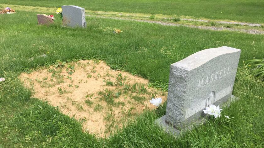 The grave site of Father Joseph Maskell shortly after his body was exhumed on Feb. 28, 2017.