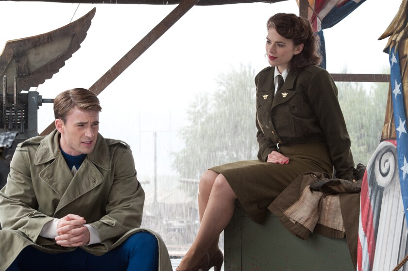 Left to right: Chris Evans plays Steve Rogers and Hayley Atwell plays Peggy Carter in the movie CAPT