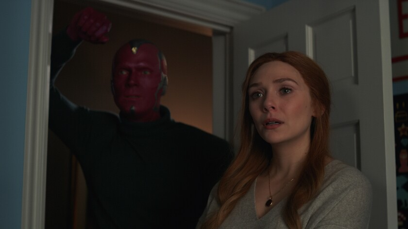 """Paul Bettany as the almost-human Vision and Elizabeth Olsen as Wanda in Marvel's """"WandaVision."""""""