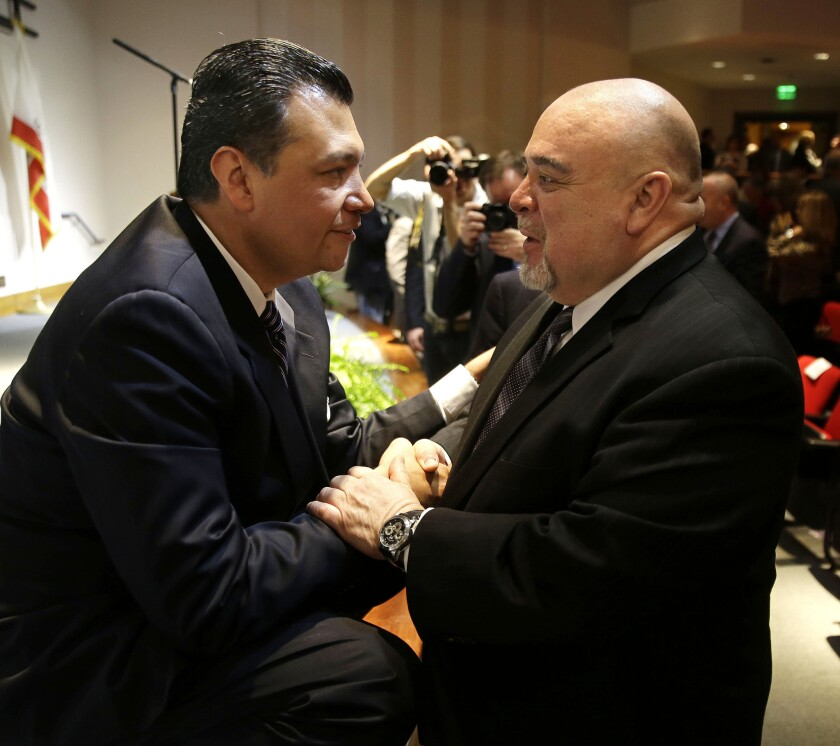 Alex Padilla, left, is congratulated by former Lt. Gov. Cruz Bustamante after he was sworn in as secretary of state in Sacramento last month.