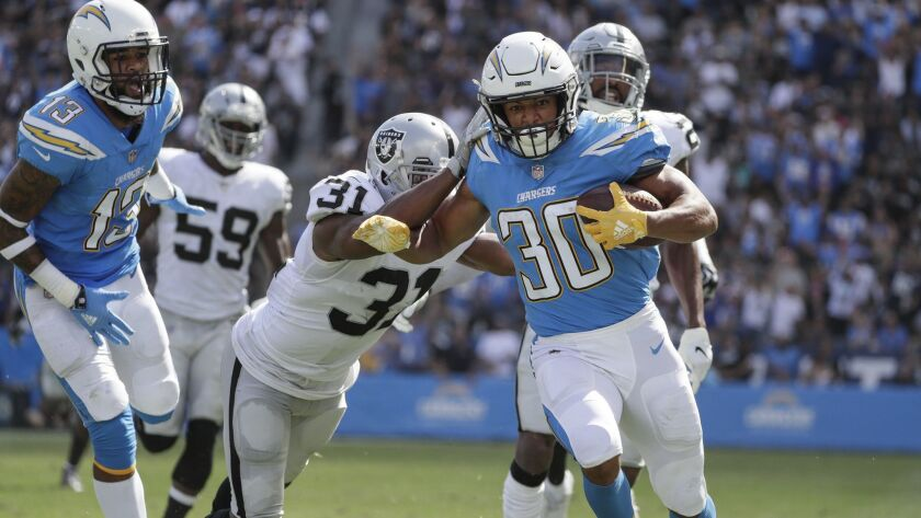 CARSON, CA, SIUNDAY, OCTOBER 7, 2018 - Chargers running back Austin Ekeler outruns the Raiders defen