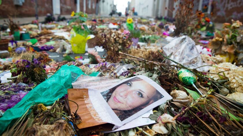 Flowers, candles and other items are placed in memory of Heather Heyer, whose image is seen in this picture, and for those affected by the violence at the site where a vehicle smashed into counter-protesters in Charlottesville, Virginia, on Aug. 24.