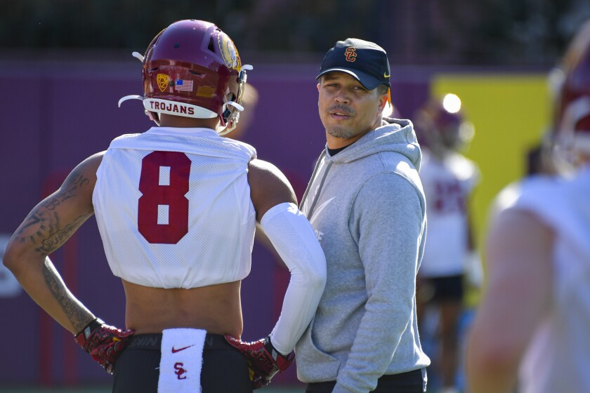 USC cornerbacks coach Donte Williams speaks with a player during a spring practice session.
