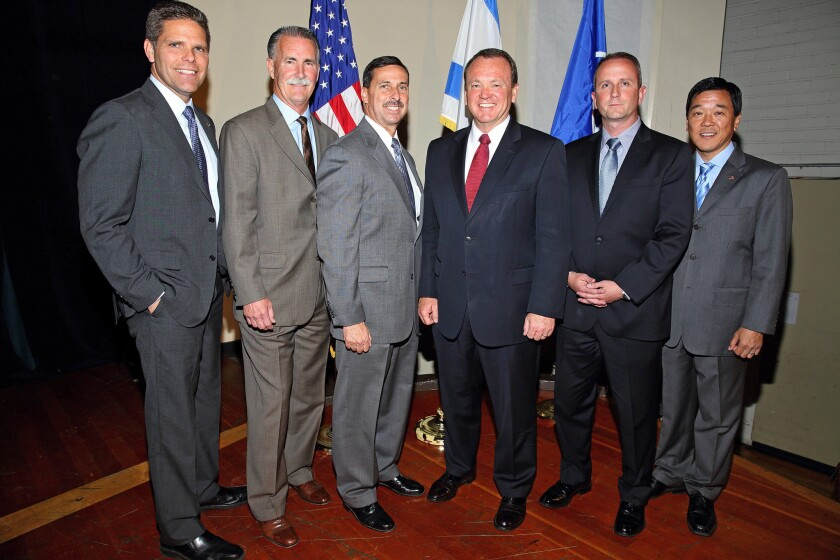 Six of the seven candidates running for Los Angeles County sheriff pose after a debate at the Jewish Community Center in Los Angeles. From left are James Hellmold, Bob Olmsted, Todd Rogers, Jim McDonnell, Lou Vince and Paul Tanaka.