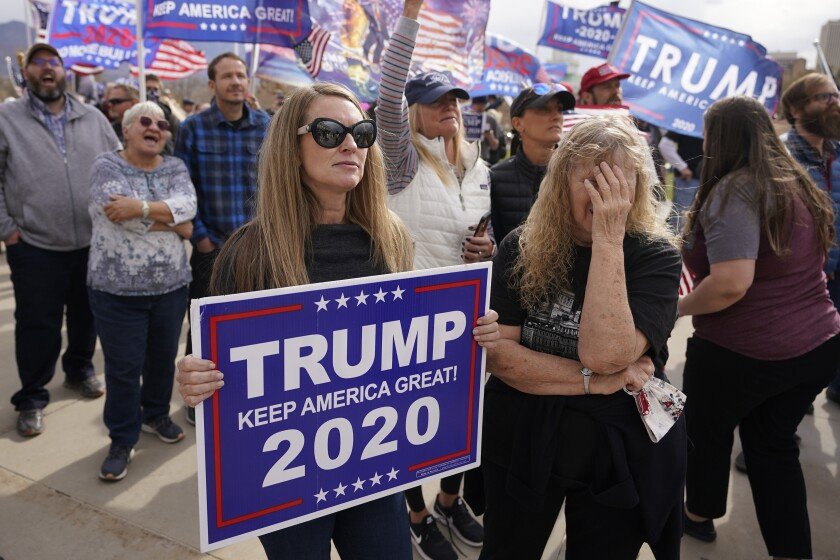 Supporters of President Donald Trump stage a rally outside the Utah State Capitol Saturday.