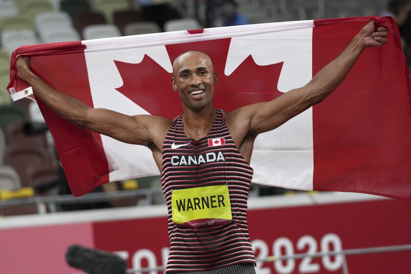 Canada's Damian Warner celebrates his Olympic victory in the decathlon Friday.