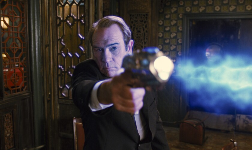 """Tommy Lee Jones stars in Columbia Pictures' action-adventure comedy movie """"Men in Black 3."""" Prime Focus, which did visual effects and 3-D conversion work on the movie, is a bidder for Rhythm & Hues."""