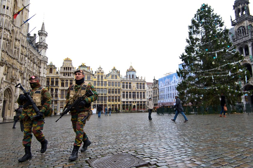 Armed soldiers patrol Tuesday in Brussels.