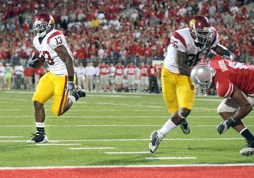 Trojans tailback Stafon Johnson gets outside the block of tight end Anthony McCoy to score the eventual winning touchdown against Ohio State on Saturday.