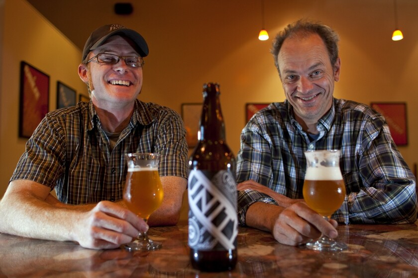 Jeremy Raub, co-owner of Eagle Rock Brewery, left, and Mark Jilg of Craft Brewery in Pasadena have created a beer called Unity for L.A. Beer Week.