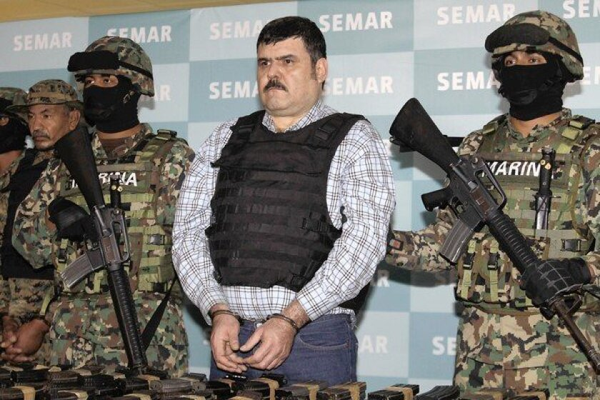 "Mexican marines flank Jorge Eduardo Costilla Sanchez, alias ""El Coss,"" as he is shown before the news media in Mexico City. Costilla was arrested this week in Tampico, a port city in Tamaulipas state."