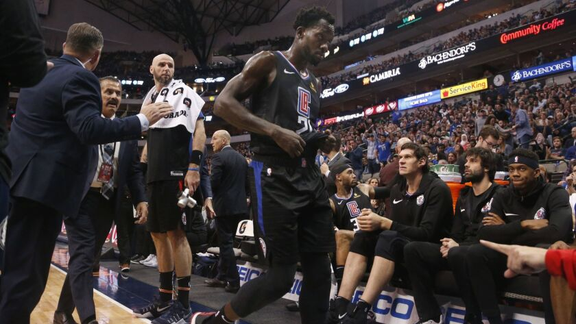 Clippers guard Patrick Beverley is ejected from the game against the Dallas Mavericks for throwing a ball at a fan during the second half on Sunday in Dallas.
