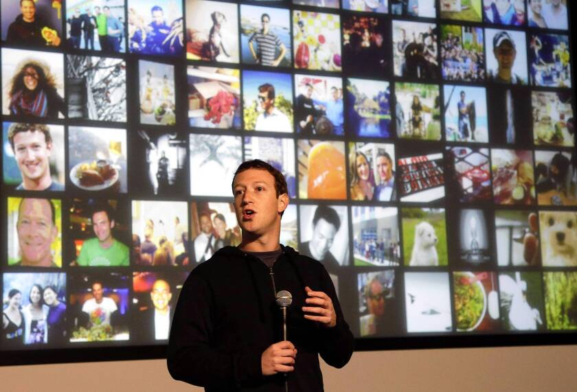 Facebook's mobile ad push takes toll on profit