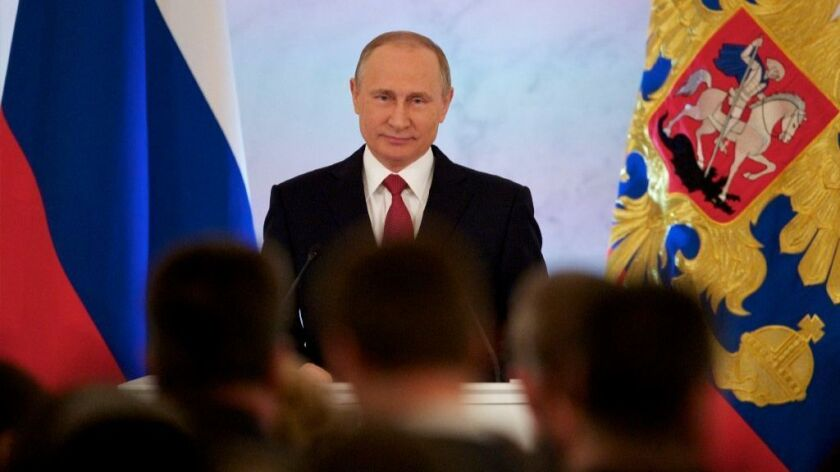 Russian President Vladimir Putin gives his annual state of the nation address in the Kremlin in Moscow on Dec. 1, 2016.
