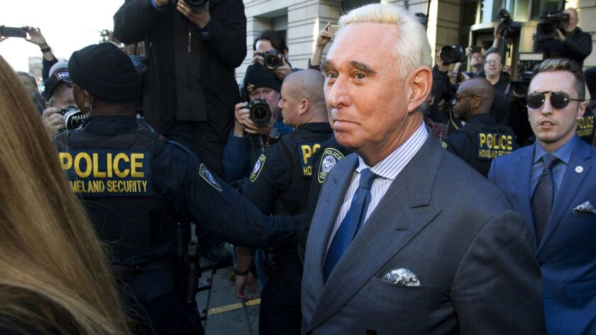 Roger Stone, a former campaign advisor for President Trump, leaves federal court in Washington on Thursday. A judge imposed a full gag order on Stone after he posted a photo on Instagram of the judge with what appeared to be the crosshairs of a gunsight.