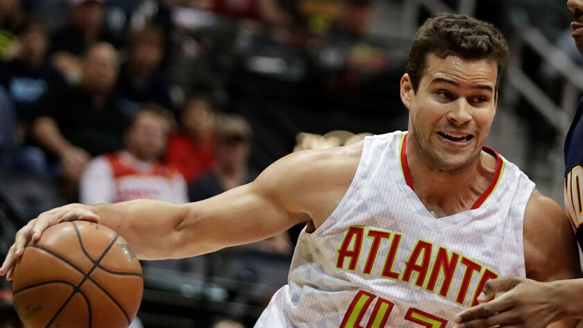 Atlanta Hawks' Kris Humphries, left, plays against Indiana Pacers' Lavoy Allen (5) in the first quar