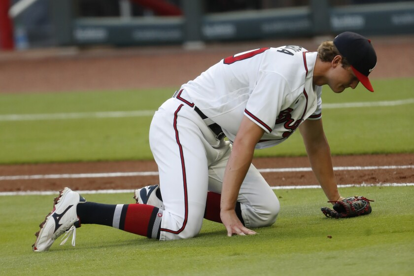Atlanta Braves starting pitcher Mike Soroka (40) waits for assistance from the training staff after being injured in the third inning of a baseball game against the New York Mets Monday, Aug. 3, 2020, in Atlanta. Soroaka was helped to the dugout and replaced. (AP Photo/John Bazemore)