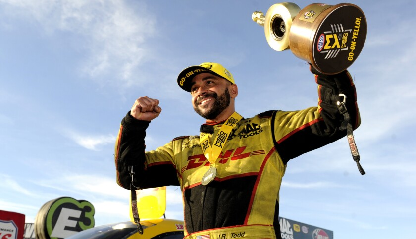 In this photo provided by the NHRA, J.R. Todd celebrates after getting his fifth win of the year in