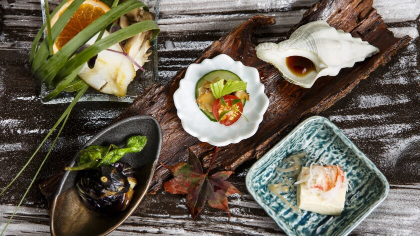 A selection of dishes from at n/naka restaurant in Los Angeles.