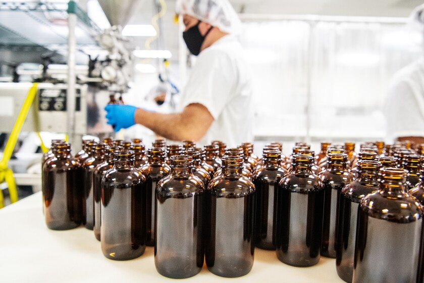 Bottles lined up on an industrial table