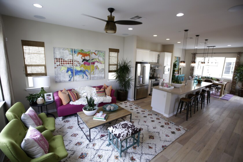 The kitchen and living room of a model home at MBK Homes' new Anaheim community named Anacasa.