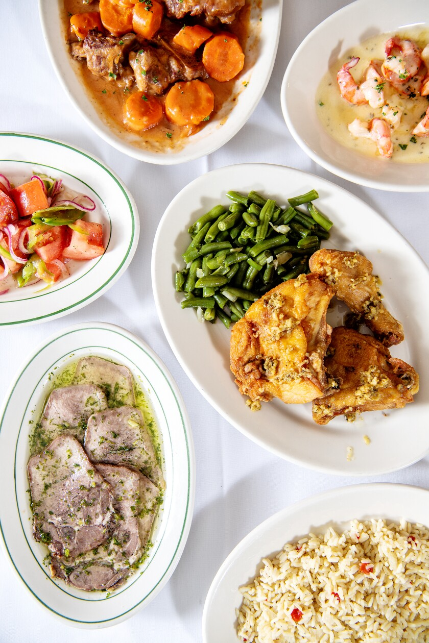 Wool Growers' oxtail stew, clockwise from top, shrimp scampi, fried chicken and beef tongue.