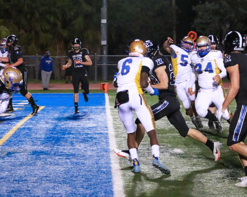 Running back Cash Jones heads in for a touchdown in the Bulldogs' 40-0 win over San Pasqual on March 19.