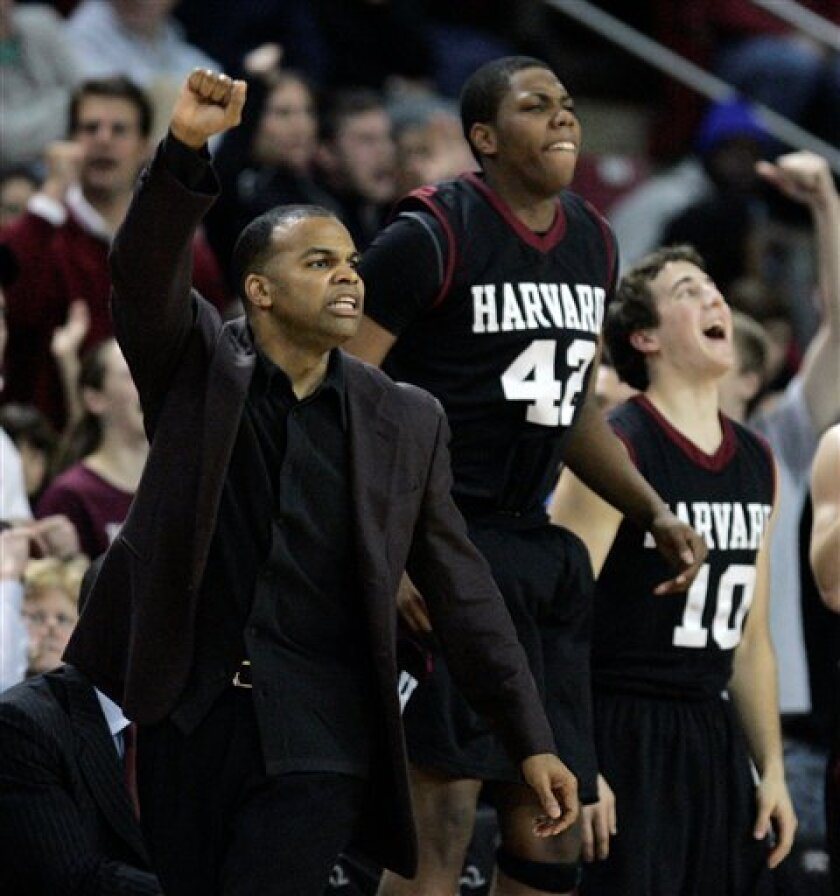 Harvard coach Tommy Amaker, left, Keith Wright (42) and Drew Housman (10) react to a Harvard basket in the second half of an NCAA college basketball game against Boston College, Wednesday, Jan. 7, 2009, in Boston. Harvard won 82-70. (AP Photo/Michael Dwyer)