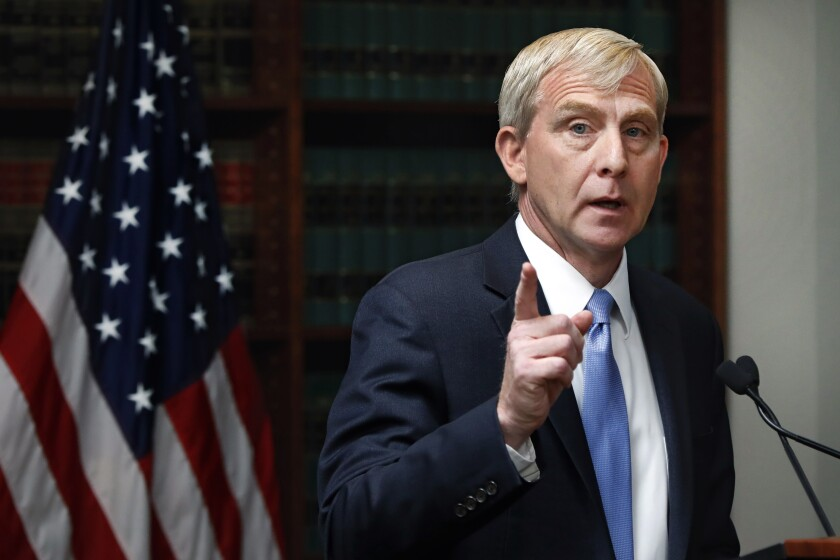 FILE - In this Tuesday, July 16, 2019, file photo, Richard Donoghue, U.S. Attorney for the Eastern District of New York, speaks during a news conference in his office, in the Brooklyn borough of New York. Donoghue, the U.S. attorney for the Eastern District of New York, told his staff Thursday, July 2, 2020, that he is leaving his post for a job at the U.S. Justice Department in Washington, and will become the top deputy to Deputy Attorney General Jeffrey A. Rosen. (AP Photo/Richard Drew, File)