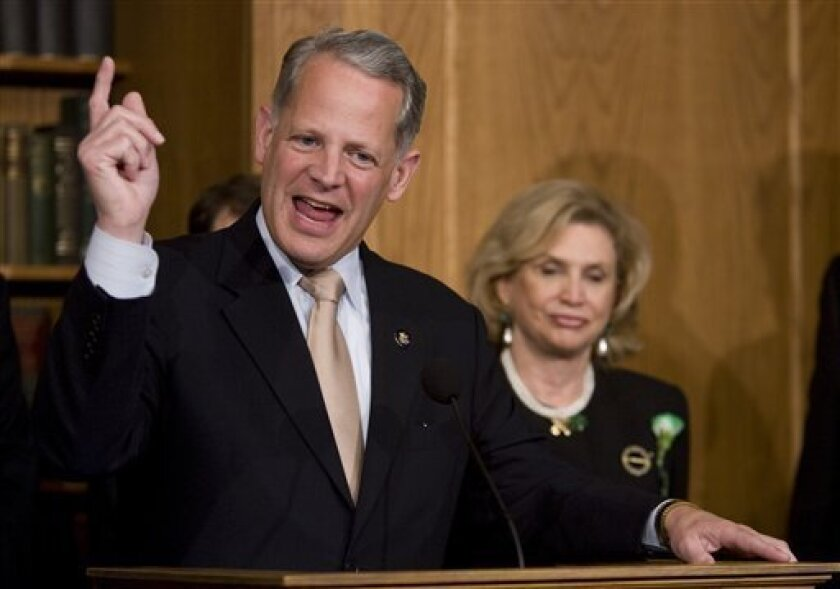 Rep. Steve Israel, D-N.Y., left, accompanied by Rep. Carolyn Maloney, D-N.Y., gestures during a news conference on Capitol Hill in Washington, Tuesday, March 17, 2009, to discuss AIG bonuses   (AP Photo/Evan Vucci)